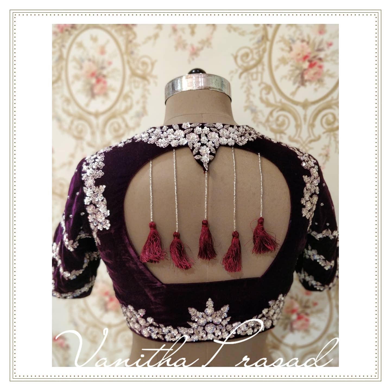 Stunning purple color velvet cloth designer blouse with silver flower zardosi work blouse. 2021-07-24