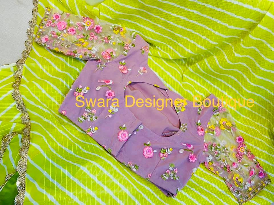Gorgeous parrot green color leheriya saree and lavender blouse with embroidery work.  2021-07-24