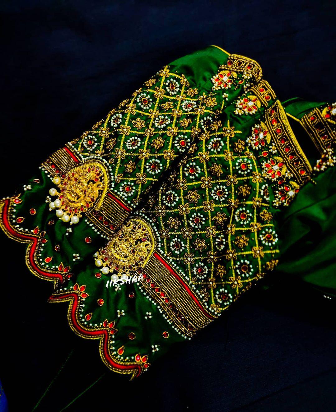 Stunning bottle green color bridal blouse with lakshmi devi motif and bead aari work. 2021-07-24