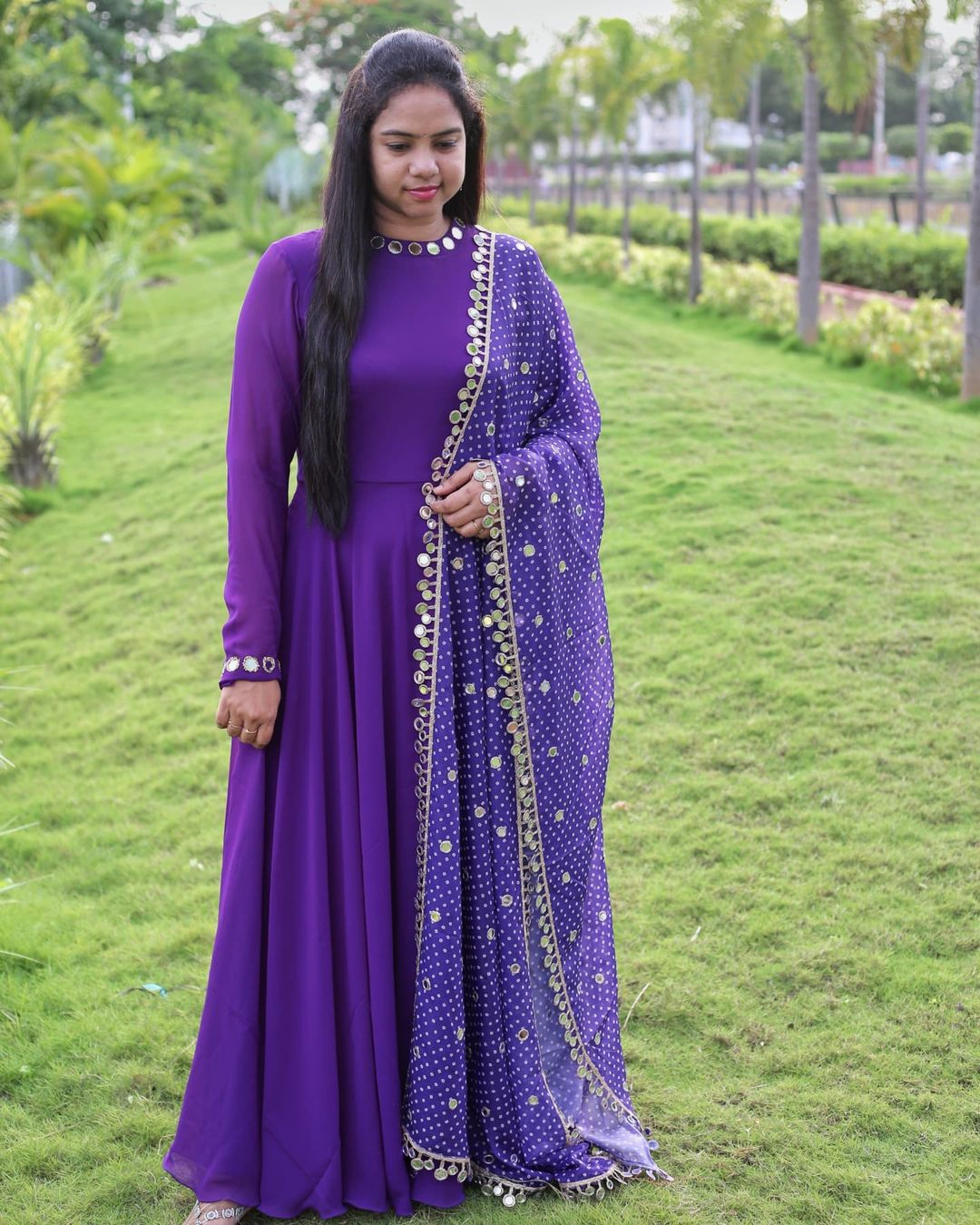 Purple high necked with mirror work neckline detailing longfrock paired beautiful bhandini dupatta with real mirrors work all over and along the length of the border . This is one stunning dupatta you wouldnt want to miss having in your wardrobe ! Price : RS. 4500/- 2021-07-24