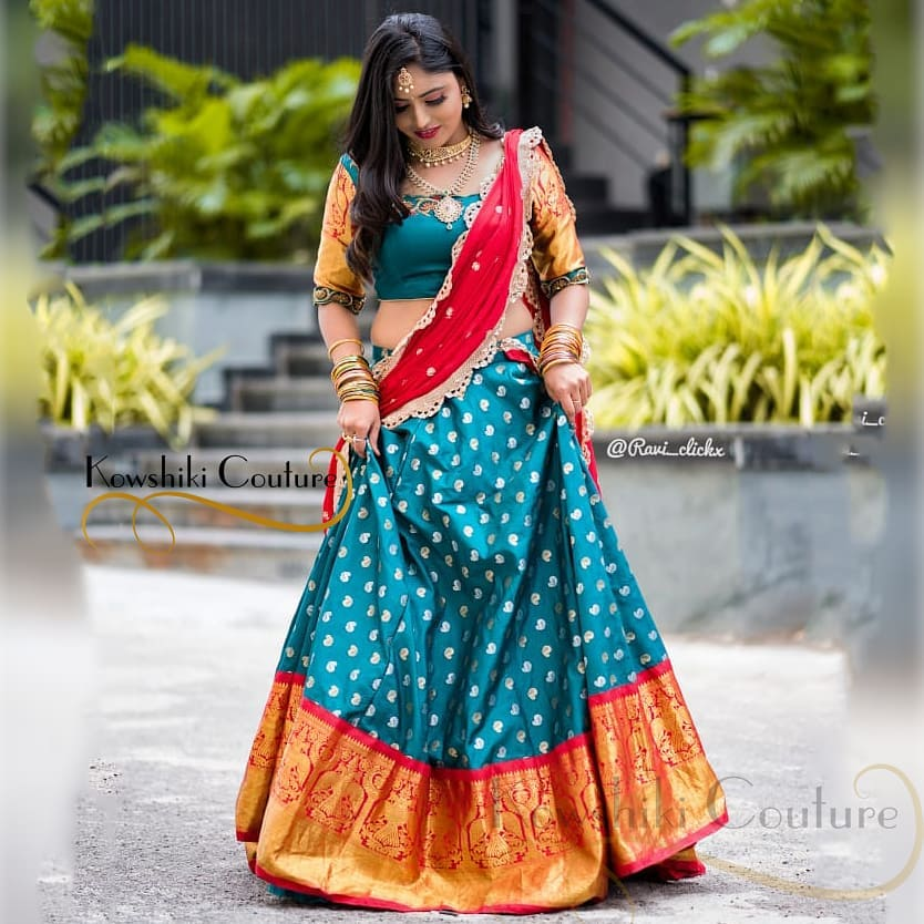 Actress Mahi Maheswari flaunting in  Pure Banarasi silk skirt with Kanchi pattu border Half saree Photography : Ravi cross clickx. Outfit : Kowshiki couture. Jewellery : Easha collections. 2021-07-25