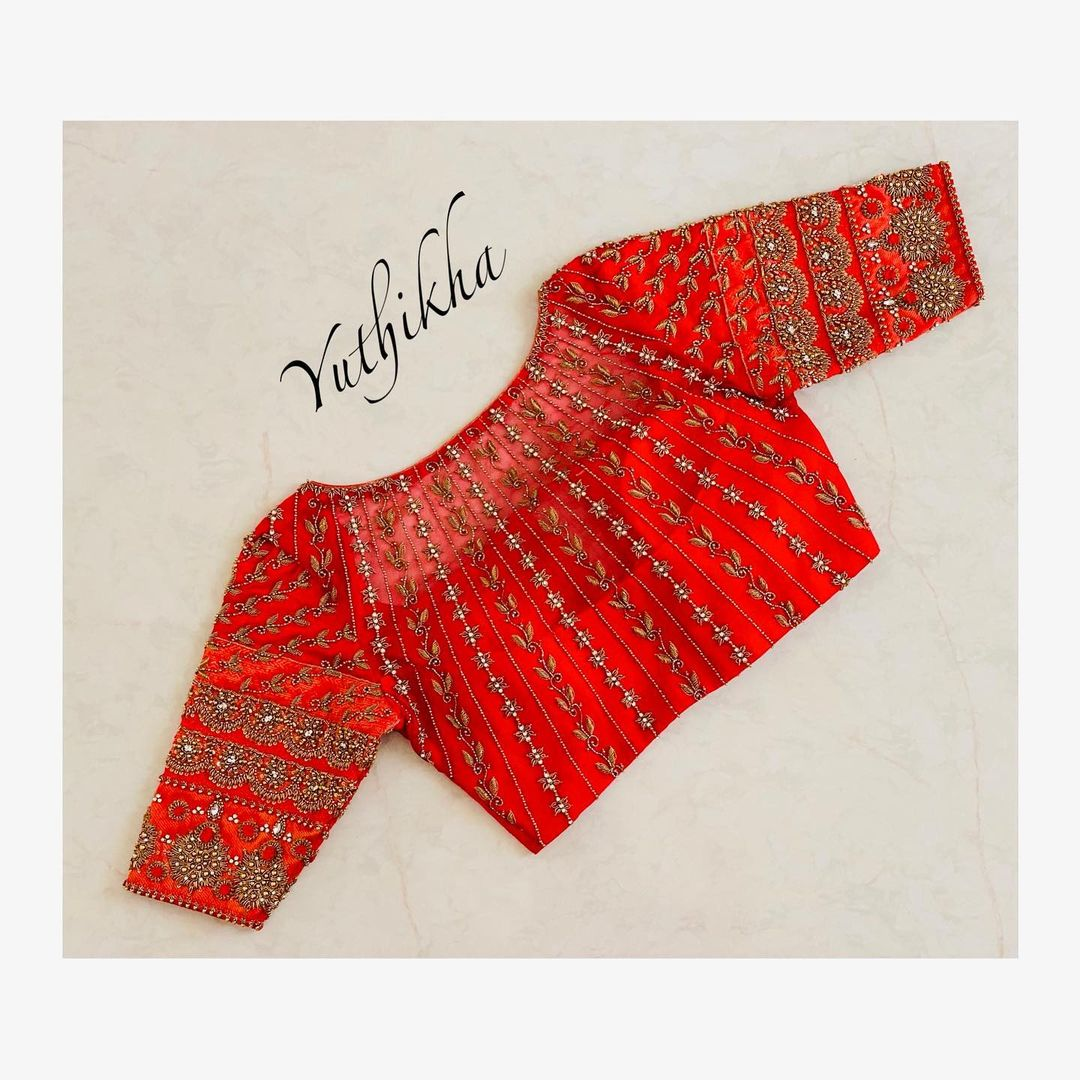 Bespoke bridal blouse With Net embroidery. Stunning red wedding blouse with floral and creeper hand embroidery maggam work.  2021-07-25