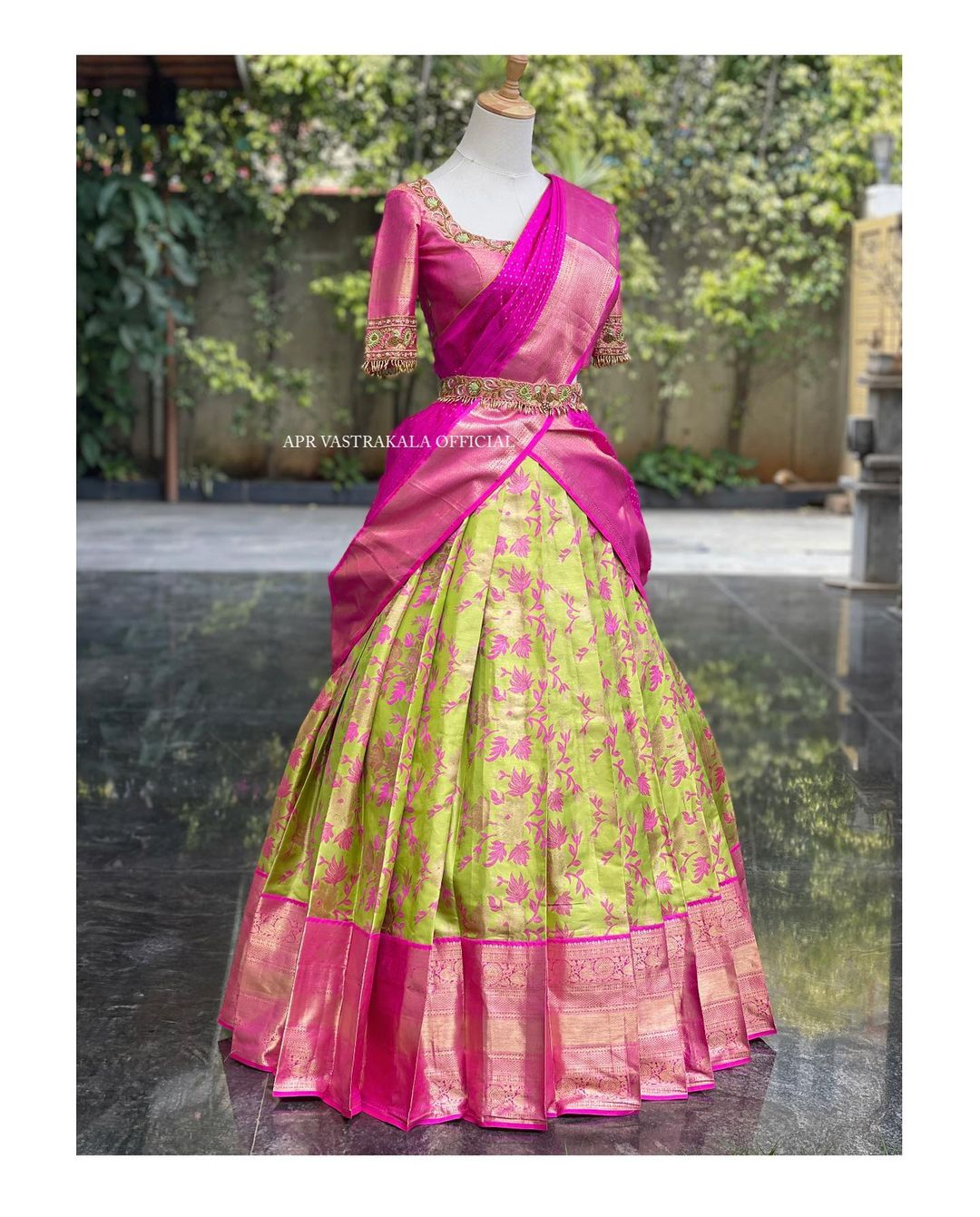 Gorgeous parrot green and pink color combination pattu langa and pattu voni. Blouse with embroidery zardosi woork.  2021-07-25