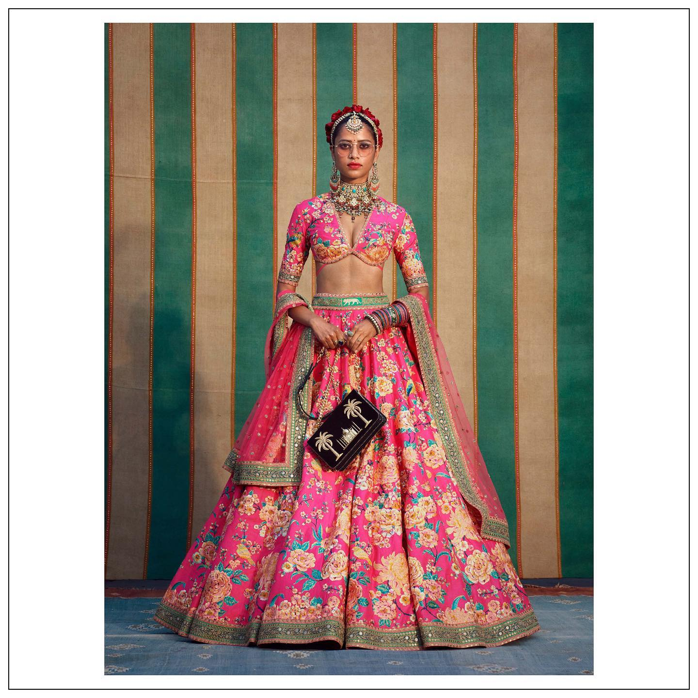 Beautiful pink color floral bridal lehenga. The Sabyasachi 2021 Collection..  For all product related queries please email at customerservice@sabyasachi.com or contact  retail stores directly. 2021-07-26