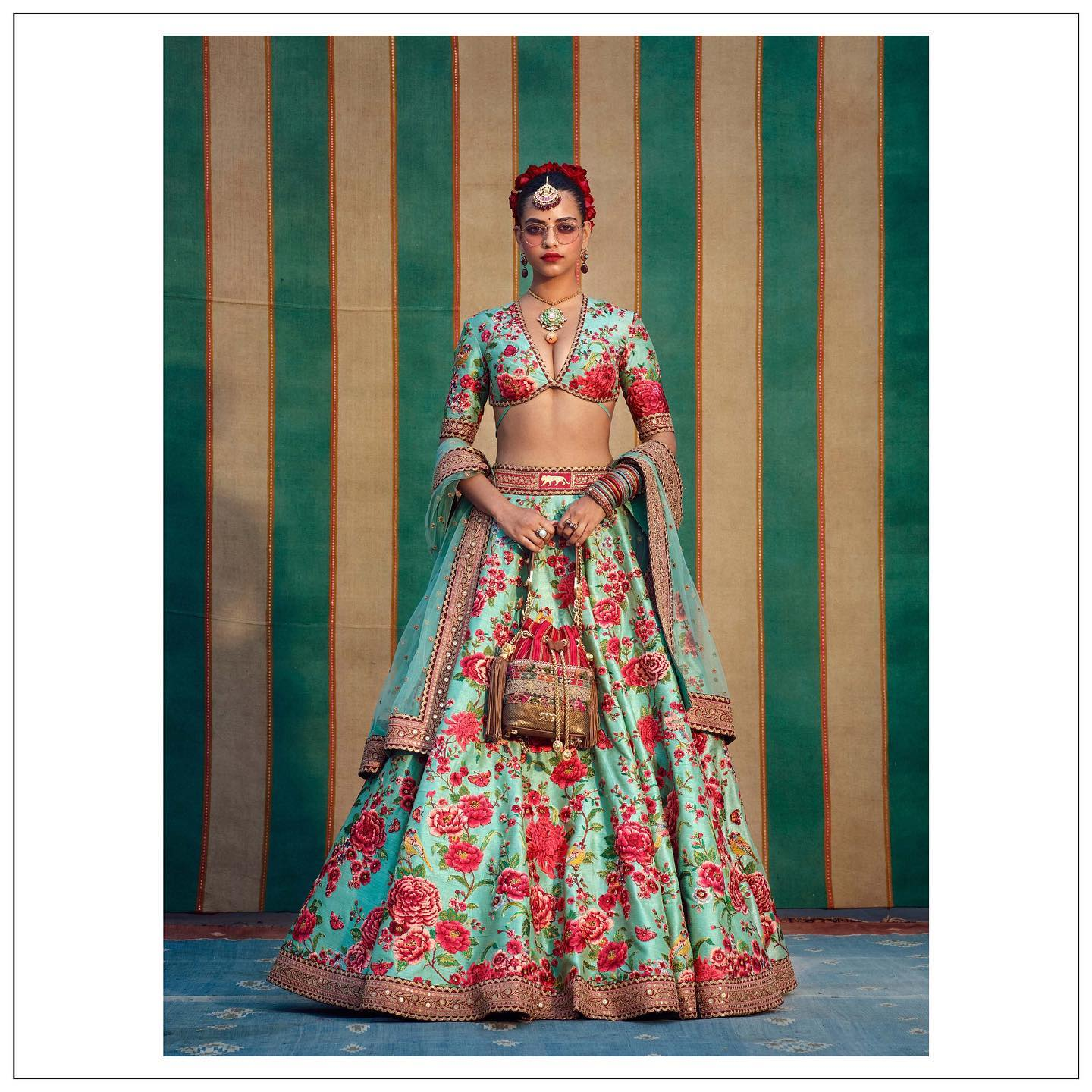 Beautiful sea green color floral bridal lehenga. The Sabyasachi 2021 Collection..  For all product related queries please email at customerservice@sabyasachi.com or contact  retail stores directly. 2021-07-26