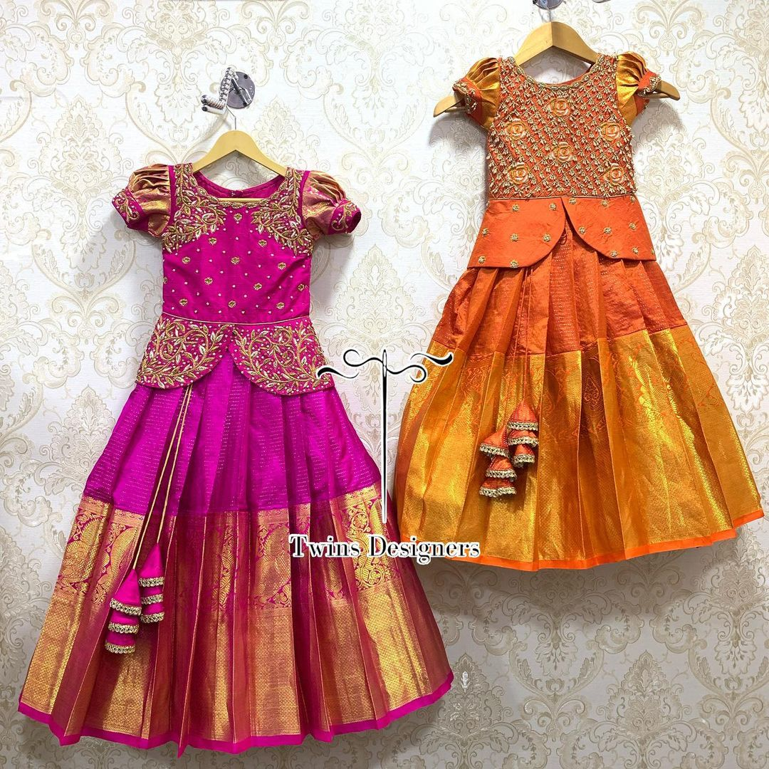 Sisters combo. Stunning pink and orange color kids pattu lehenga and long blouse. Peplum top with hand embroidery work.   2021-07-26