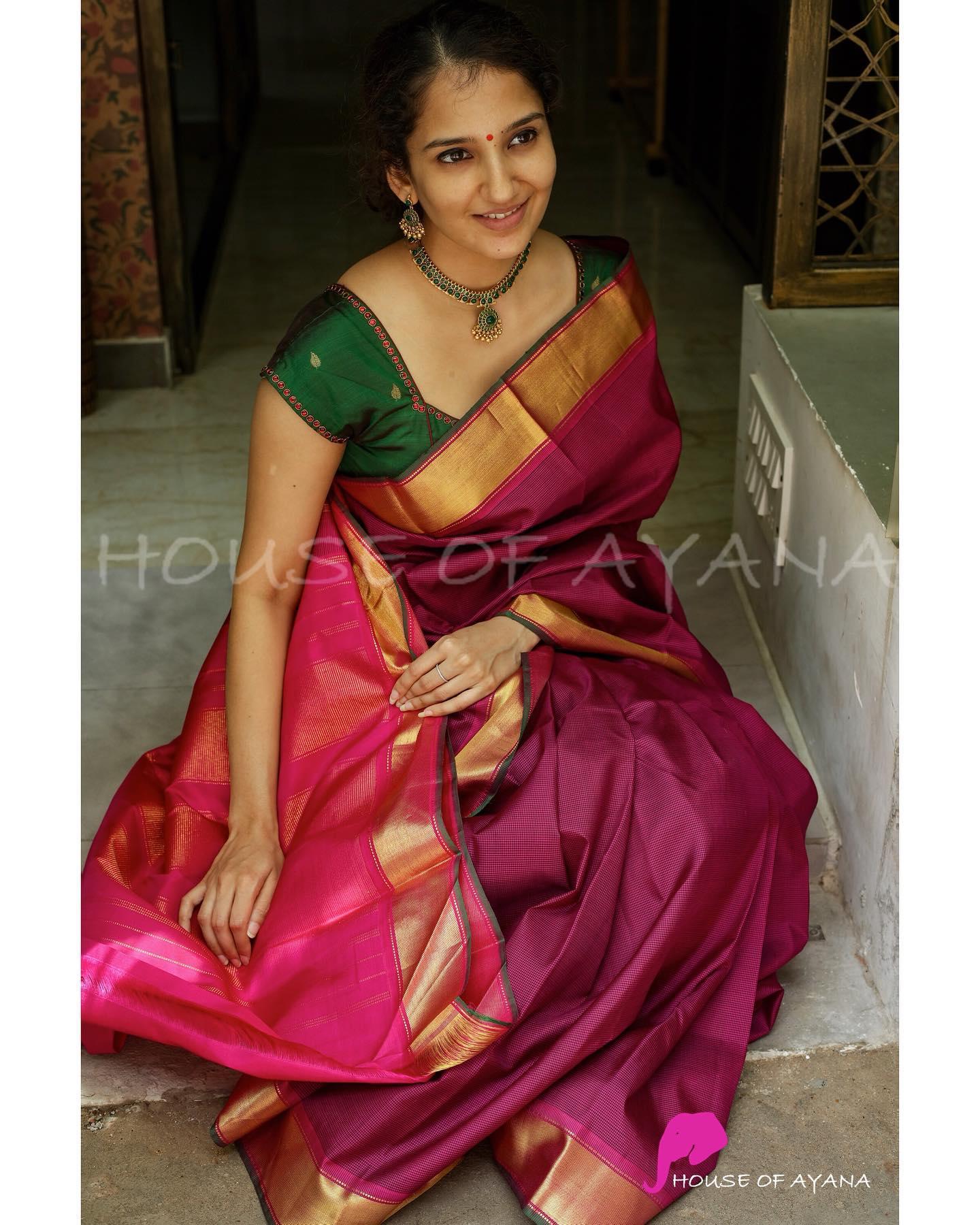 Saree: Kanjivaram pure silk handwoven with contrast borders and podi kattam all over. Blouse: Pink silk blouse with coordinated borders (as shown in last image) . 2021-07-27