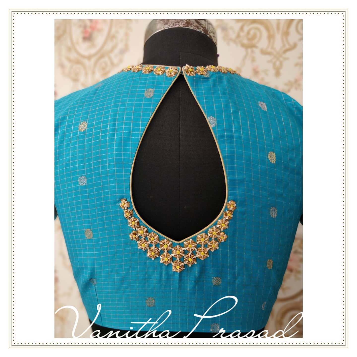 Gorgeous sky blue color V neck blouse with floral buti hand embroidery aari work on neckline. Embracing elegance in every detail. Subtly glamorised for the  initmate weddings. 2021-07-27
