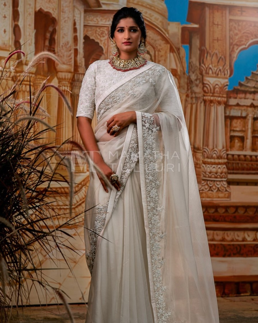 Some of your best moments of Fun have not arrived yet Indulge yourself in mesmerizing Myra weaves. Stunning pearl white color embroidery saree and blouse. 2021-07-27