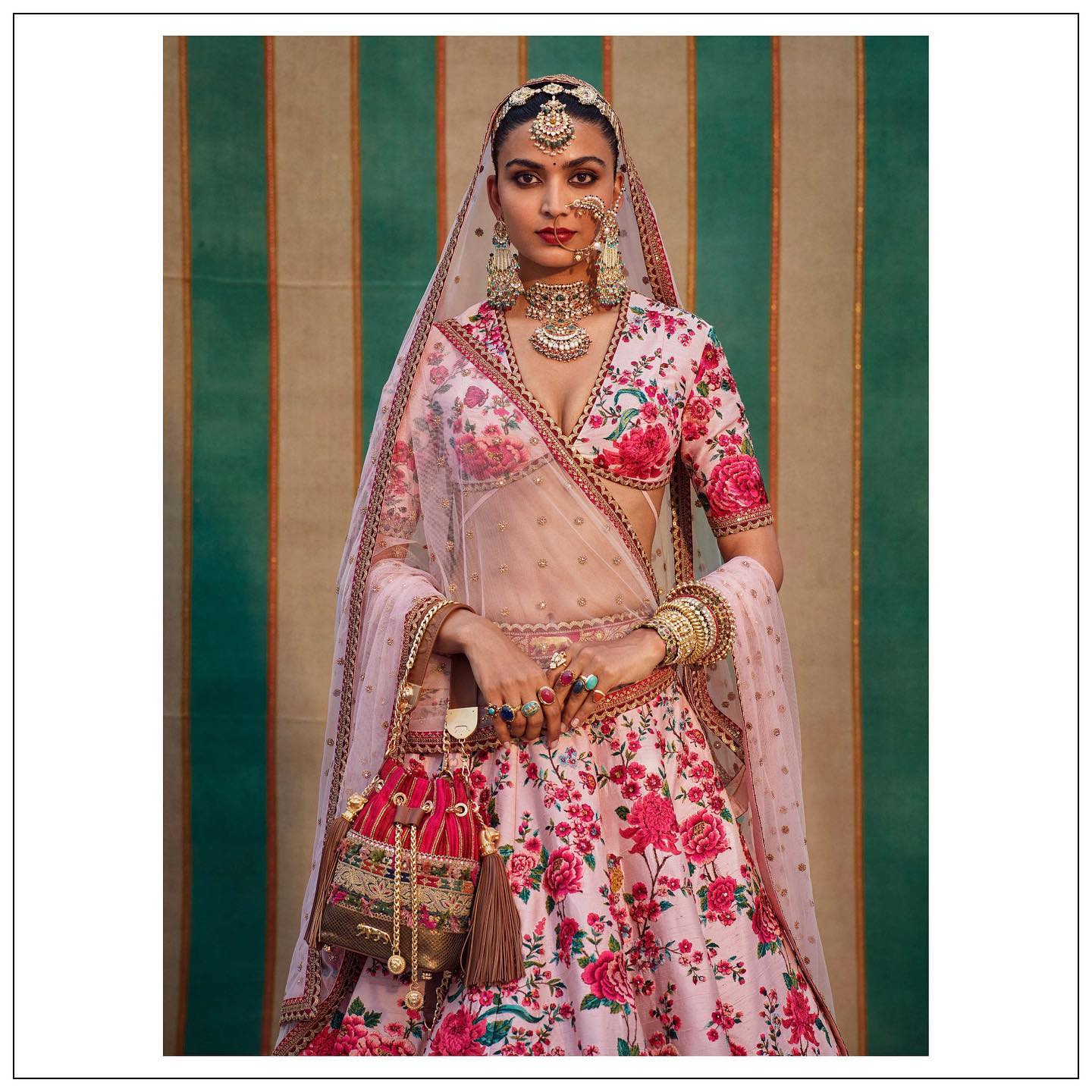 The Sabyasachi 2021 Collection. Stunning blush pink floral bridal lehenga set.  For all product related queries please email  at customerservice@sabyasachi.com or contact  retail stores directly. 2021-07-27