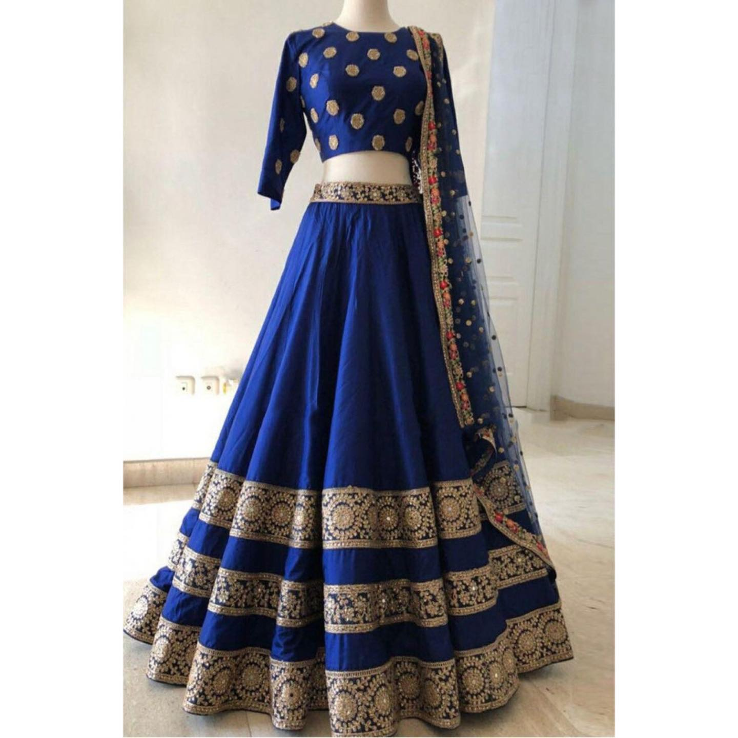 Royal blue raw silk lehenga with black sequin embroidered borders.   The blouse is an sequin motif embroidered one. Dupatta is a sequin embroidered net with a multicolor border.  2021-07-27