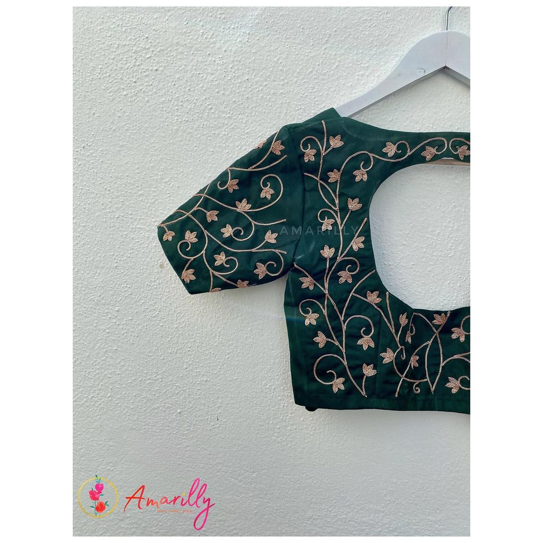 Stunning bottle green color simple blouse with creeper and floral hand embroidery maggam work.  2021-07-27