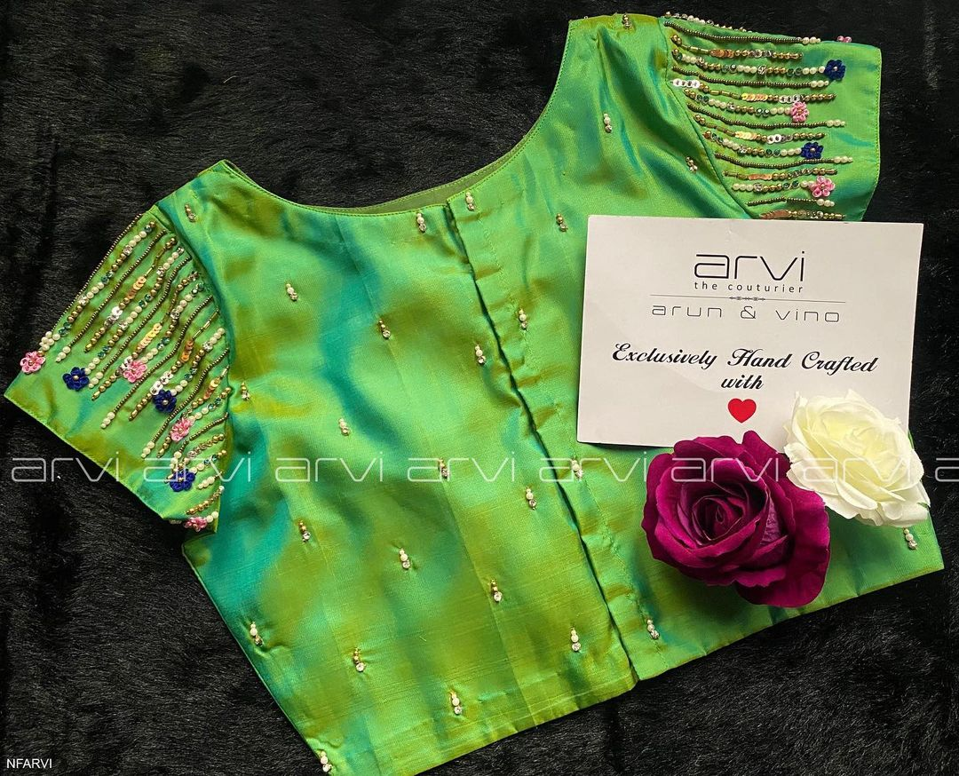 Gorgeous parrot green color blouse with classy bead aari work on sleeves and shoulder. 2021-07-27