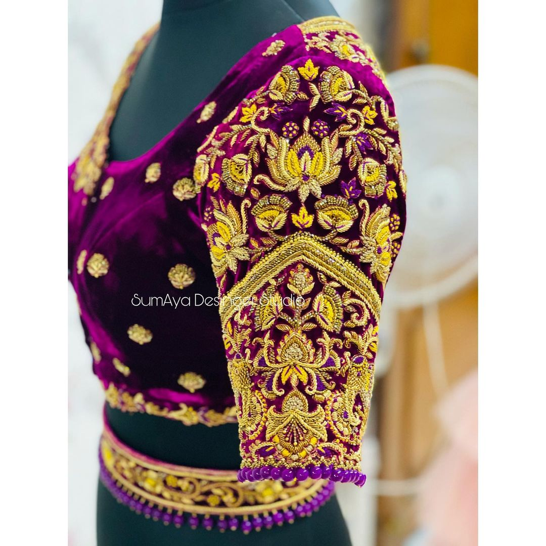 Bespoke bridal blouses.....  Classic Elegant and versatile hand crafted Bespoke bridal collections  Stunning purple color velvet cloth bridal blouse sleeve with heavy maggam work. 2021-07-27