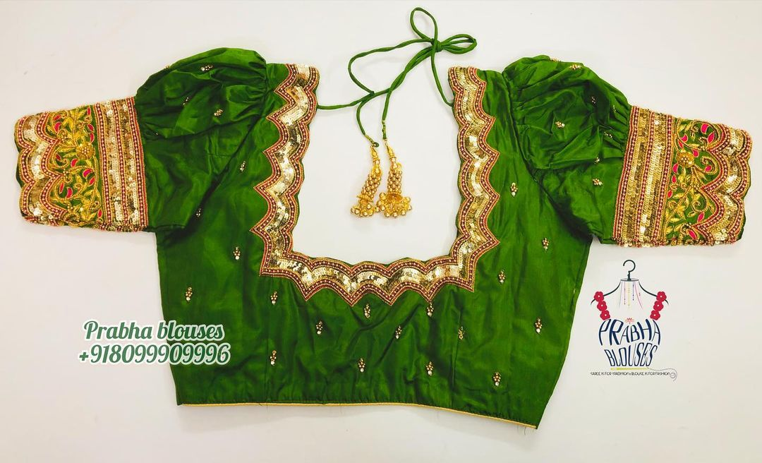 Stunning parrot green color puff sleeves floral and creeper hand embroidery thread and bead aari work.  2021-07-27