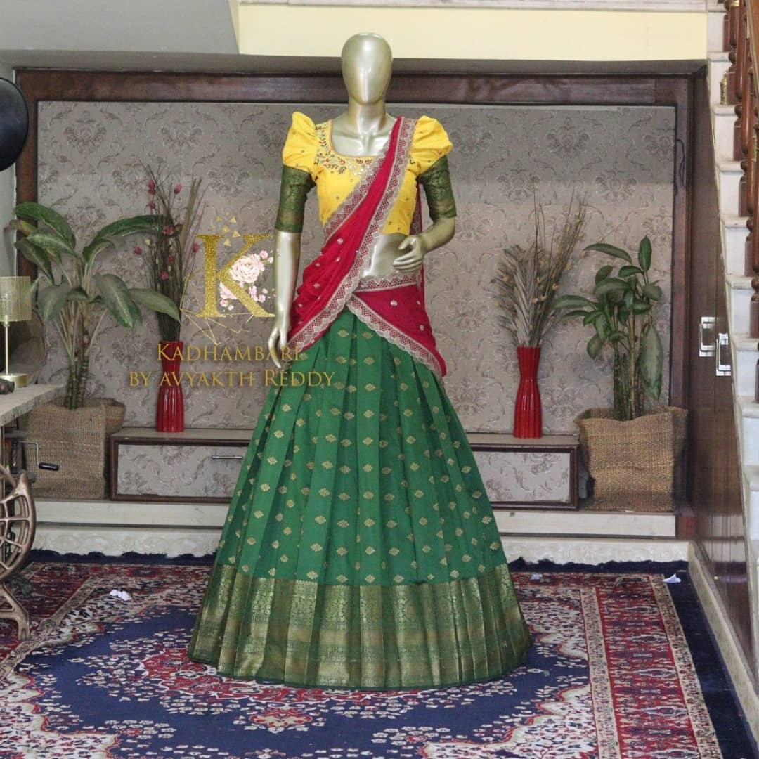 Traditional Half Saree Set. Gorgeous green pattu lehenga and yellow blouse with net dupatta. This outfit is Available at Rs 11800/-  2021-07-27