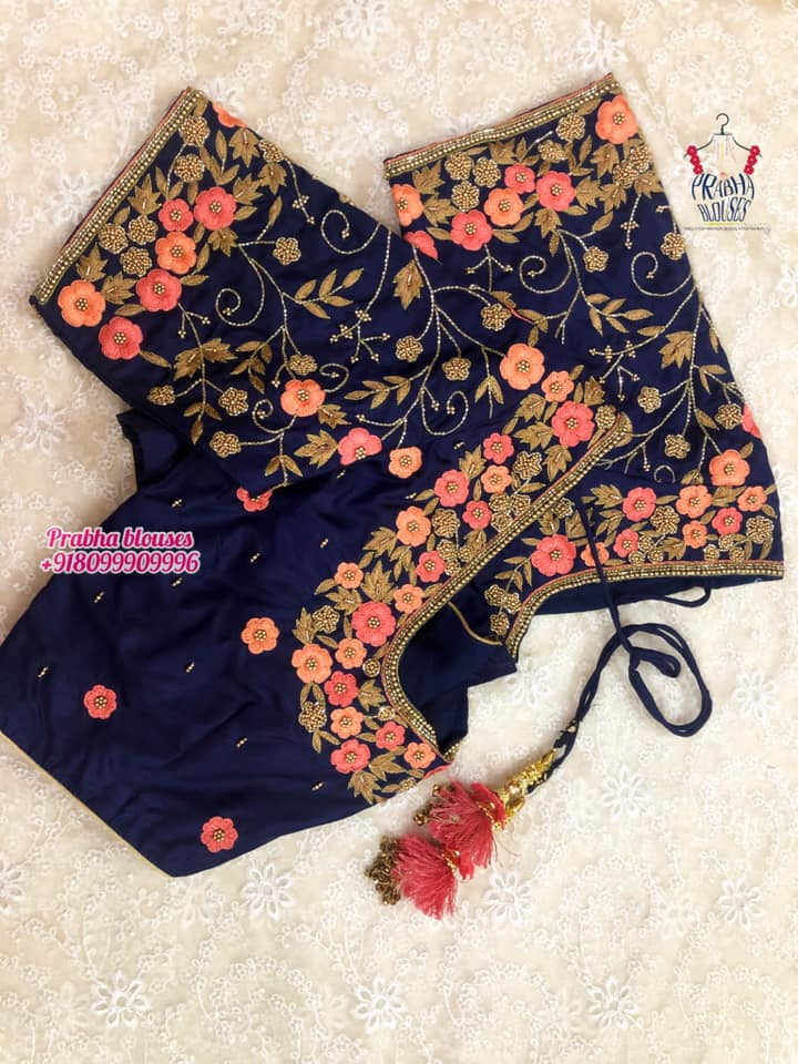 Stunning navy blue color bridal blouse with floral and creeper hand embroidery maggam work.  2021-07-28