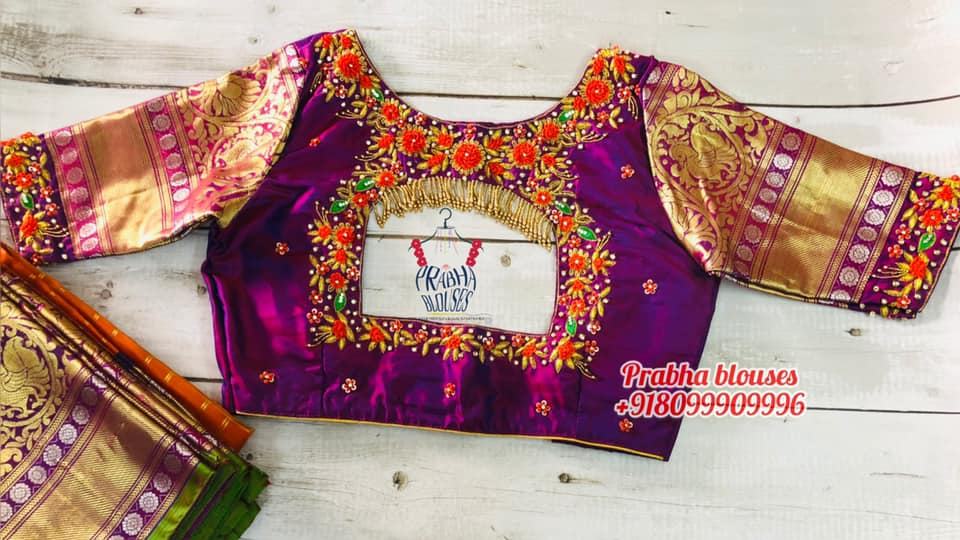 Stunning purple color bridal or wedding blouse with floral 3D maggam work. Blouse with gold jari sleeve.  2021-07-28