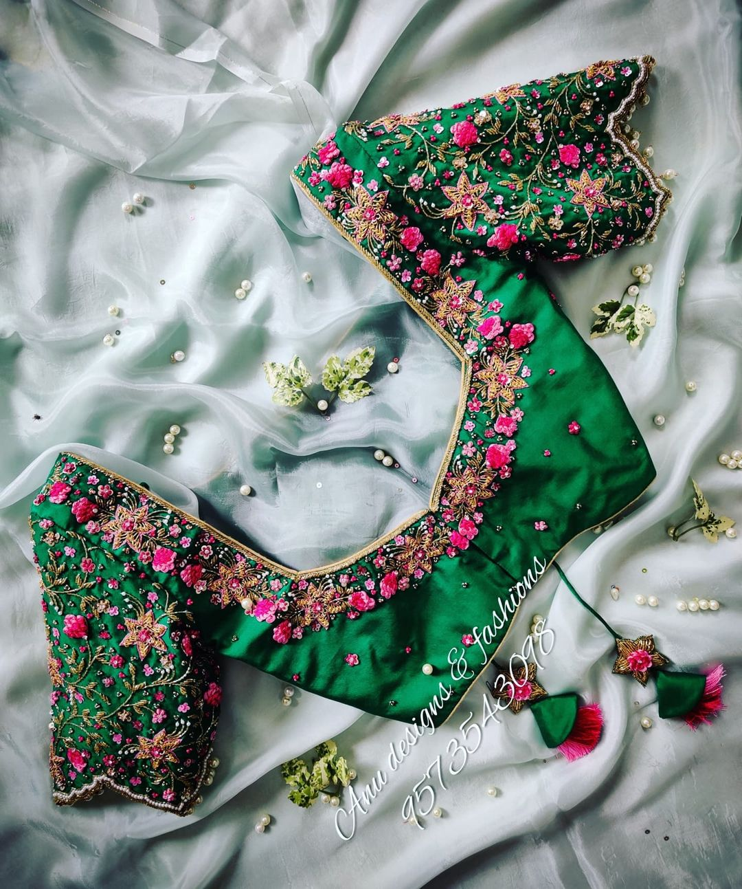 Gorgeous leaf green color bridal blouse with stars floral and creeper hand embroidery 3D maggam work. 2021-07-28