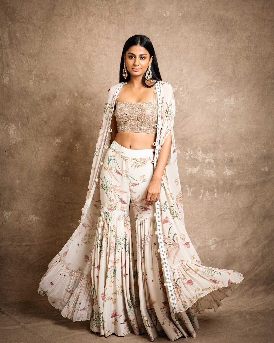 In a festive mood for floral dressing! Presenting Sand floral print sharara set with mirror detailing.   For further enquiries please connect with  team on +91 7506633202 via call or WhatsApp. 2021-07-28