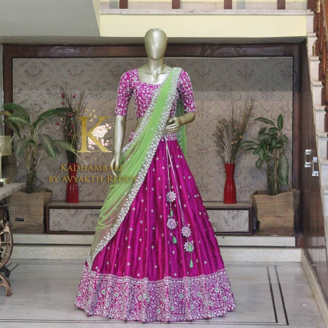 Stunning wine color bridal lehenga and blouse with pista green net dupatta. Bridal lehhenga with silver thread embroidery work.  2021-07-28