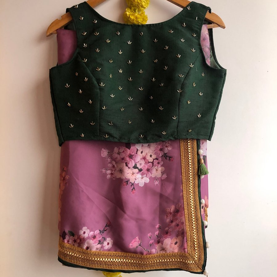 Purple silk floral saree with silk Green blouse is given a golden patti sleeves available with similar works ..!!  Watsapp  on 8072774265 Mail  on orders@Threadslabel.com 2021-07-29