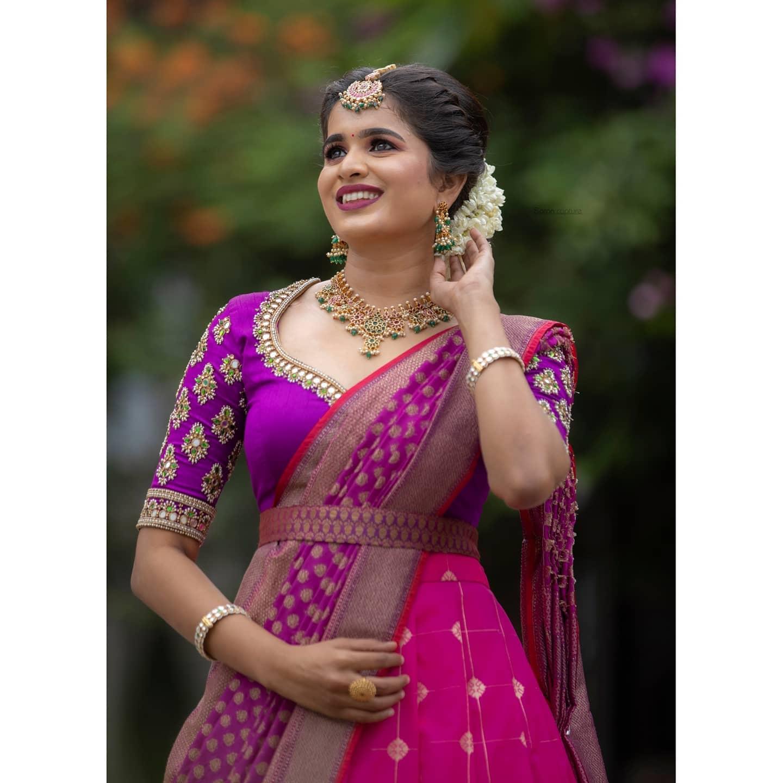 Pink and purple pattu halfsari . Stunning pink pattu lehenga and purple maggam work blouse with pattu dupatta. 2021-07-29