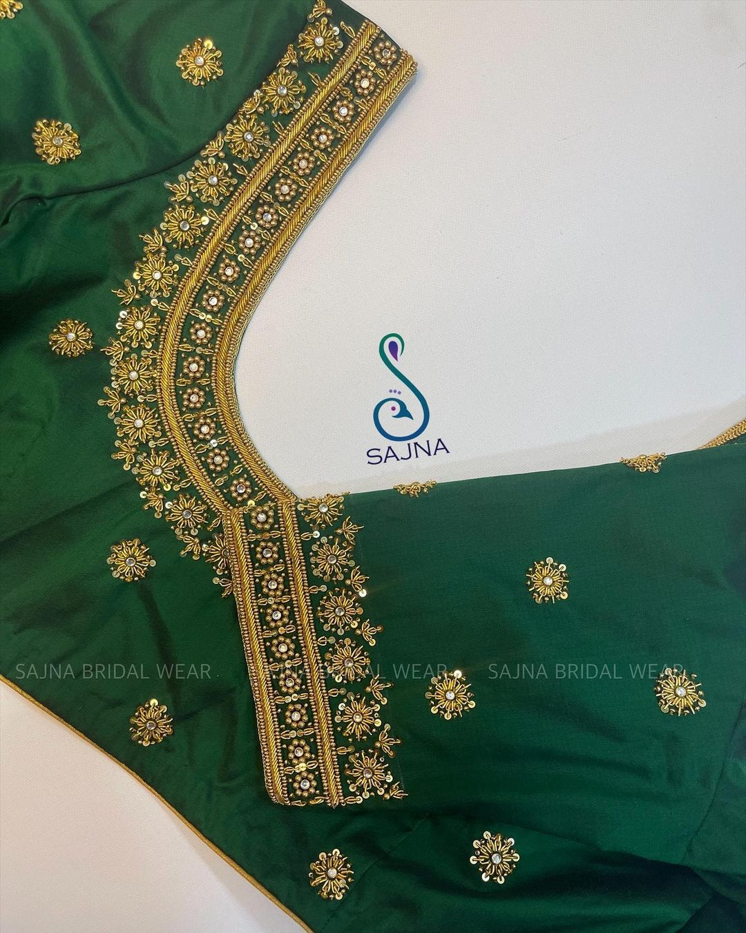 Stunning leaf green color simple bridal blouse with floral hand embroidery bead and stone aari work.  2021-07-29