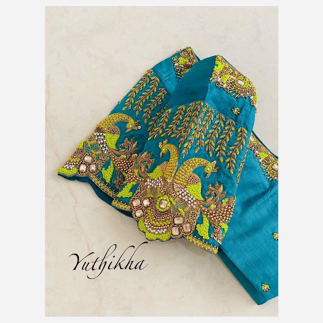 Gorgeous sky blue color blouse with peacocks embroidery maggam work on sleeves and neckline.  2021-07-29