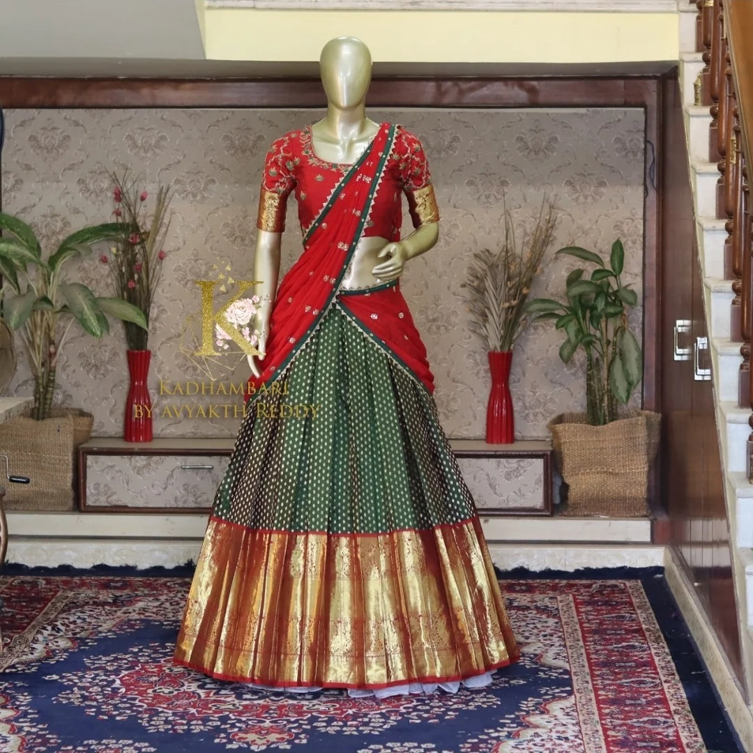 Traditional pattu halfsaree ! Stunning green pattu lehenga and red blouse with red net dyupatta. Blouse with zari sleeves and embroidery work. This outfit is Available at Rs 18000/-  2021-07-29