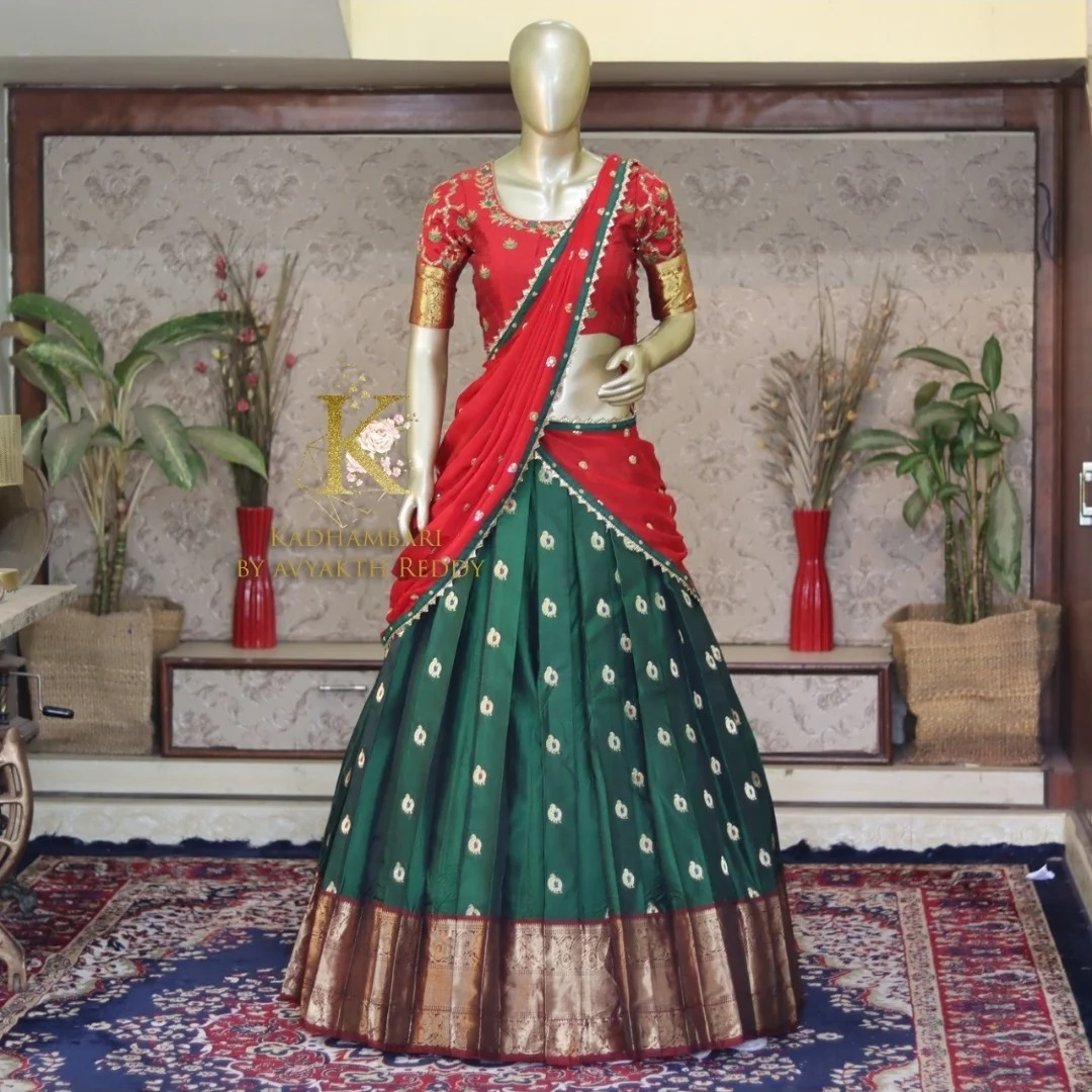 Stunning leaf green color buti jute benaaras lehenga and red hand embroidery blouse with georgete dupatta. This outfit is Availableat Rs 16800/  2021-07-30
