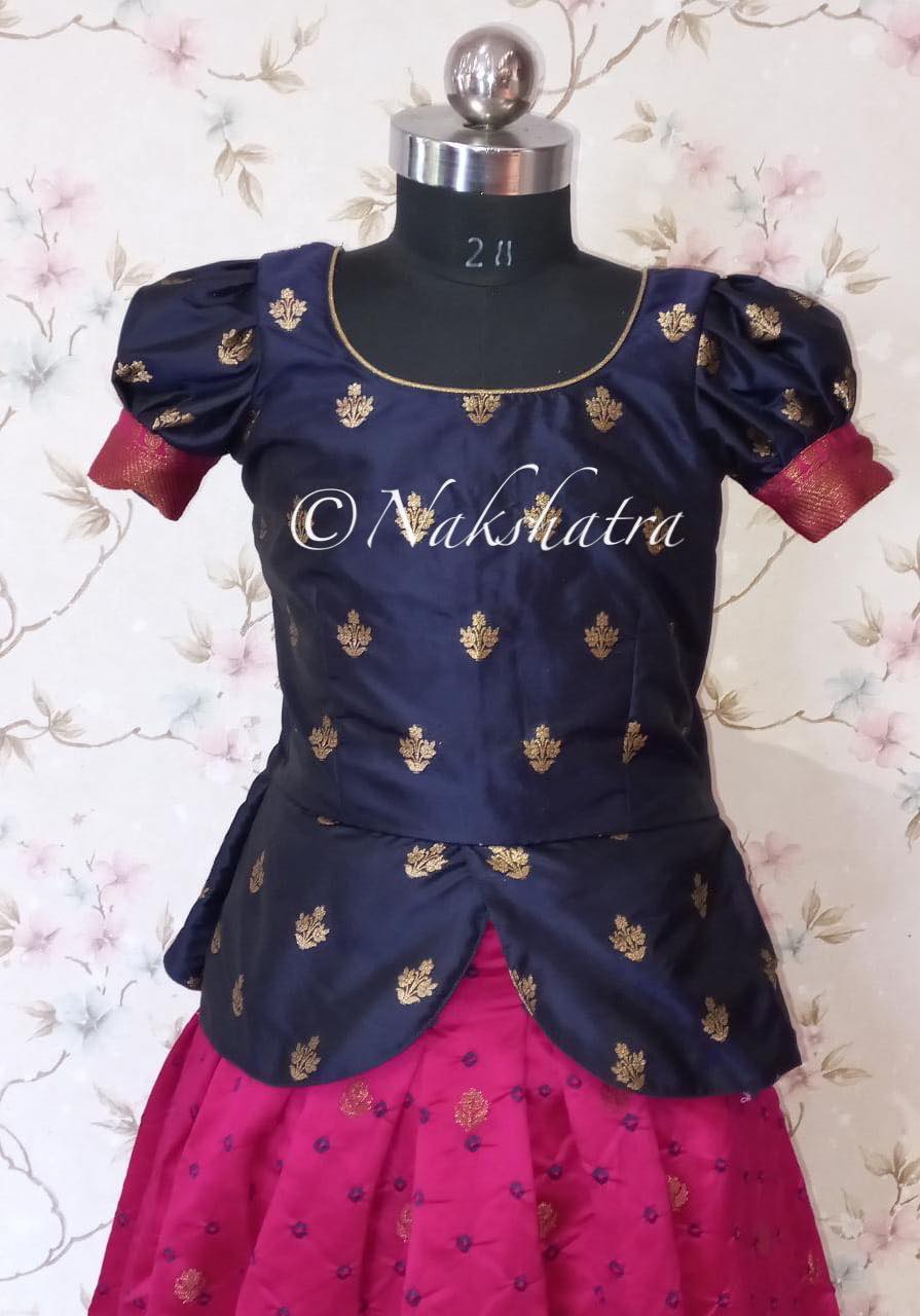 Kids pure bandhini jute silk lehangas with antique zari kanchi style borders paired with pure silk peplum style blouses with gold zari butis . Lenght of the lehanga -36in Blouse lenght -18 -20 inches Chest - 30/32in extendable upto 2 more inch.  Good for agr 10-12 years depensing on their height . 2021-07-31