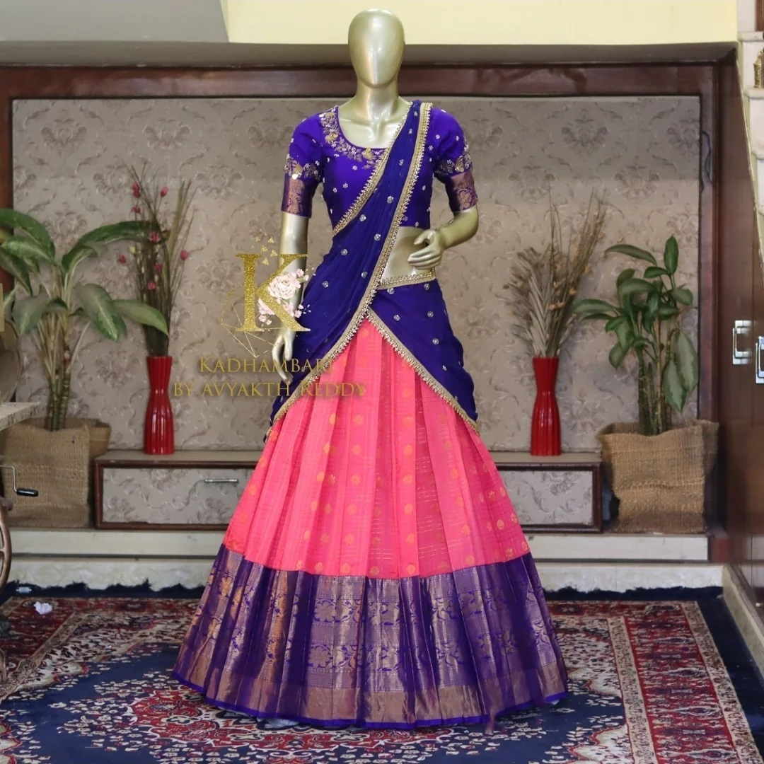 Stunning pink color silver pattu lehenga and royal blue color blouse with net dupatta. Blouse with hand embroidery work.  2021-07-31
