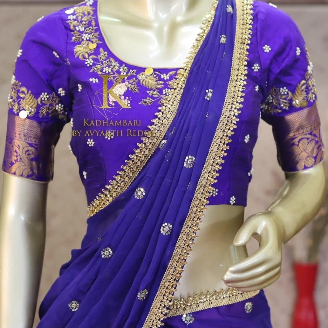 Stunning royal blue color bridal blouse with floral and creeper hand embroidery zardosi work.  2021-07-31