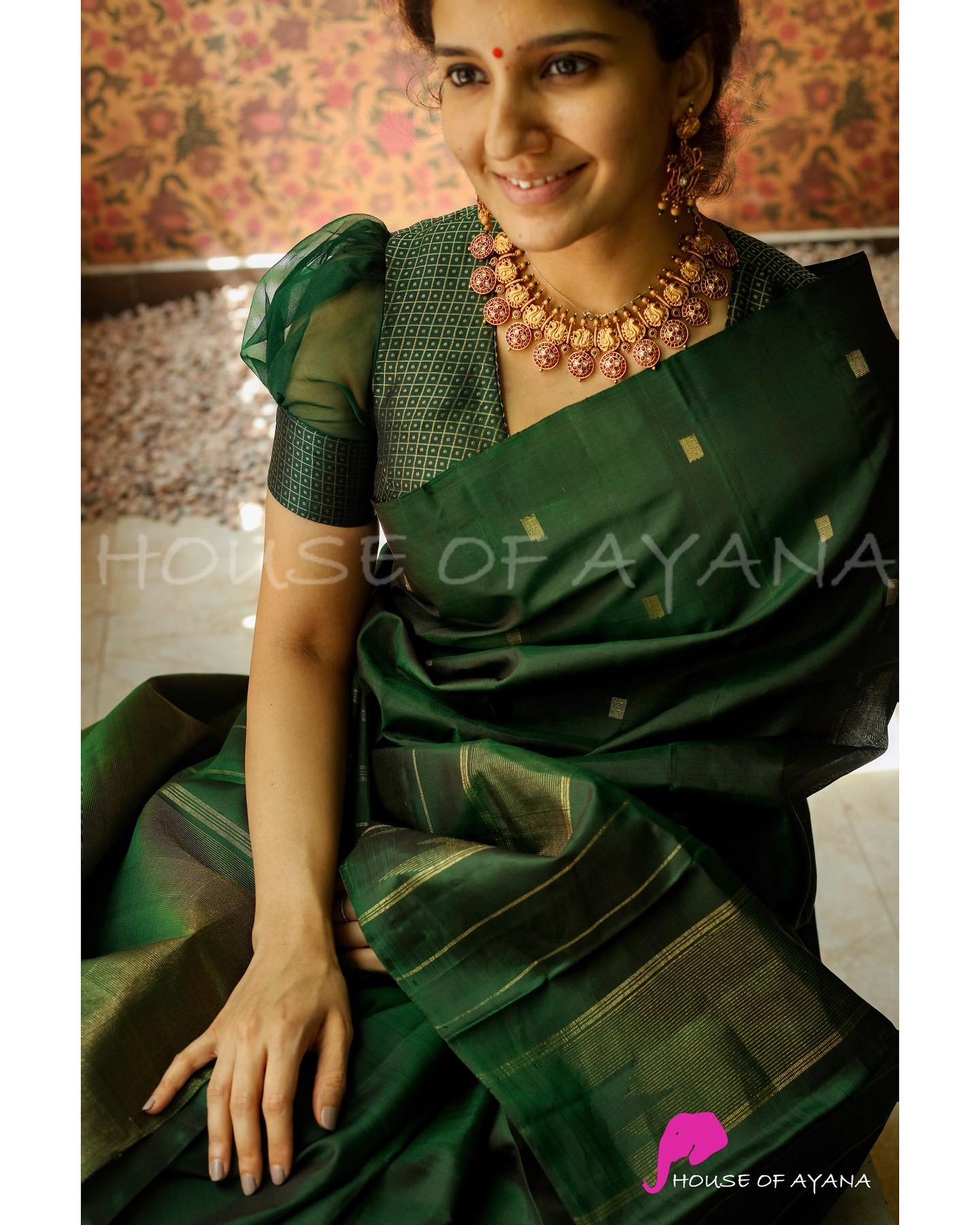 Kanjivaram pure silk handwoven saree with gold zari stripes and motifs all over Bottle green silk blouse plain The saree comes with its own blouse piece. The one worn by the model is for styling purpose only. The same is available to purchase from our ready to wear category in multiple sizes. 2021-08-01