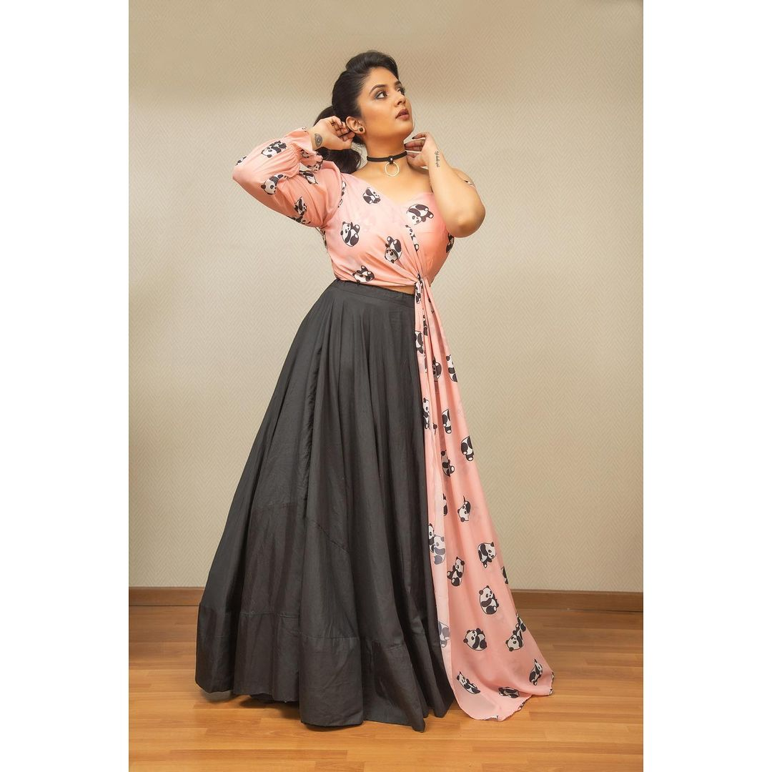 Stunning black skirt and panda print one shoulder top. Outfit : Rekhas couture. Styling : Kirthana sunil . 2021-08-01