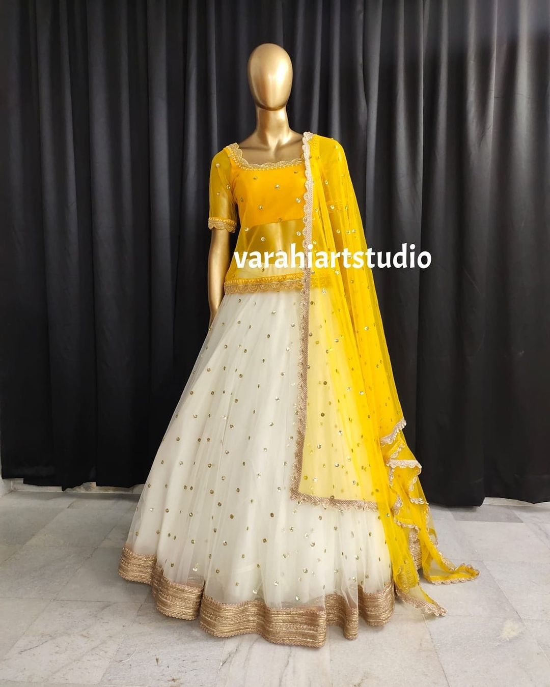 Stunning pearl white color net lehenga and yellow long blouse with net blouse. 2021-08-01