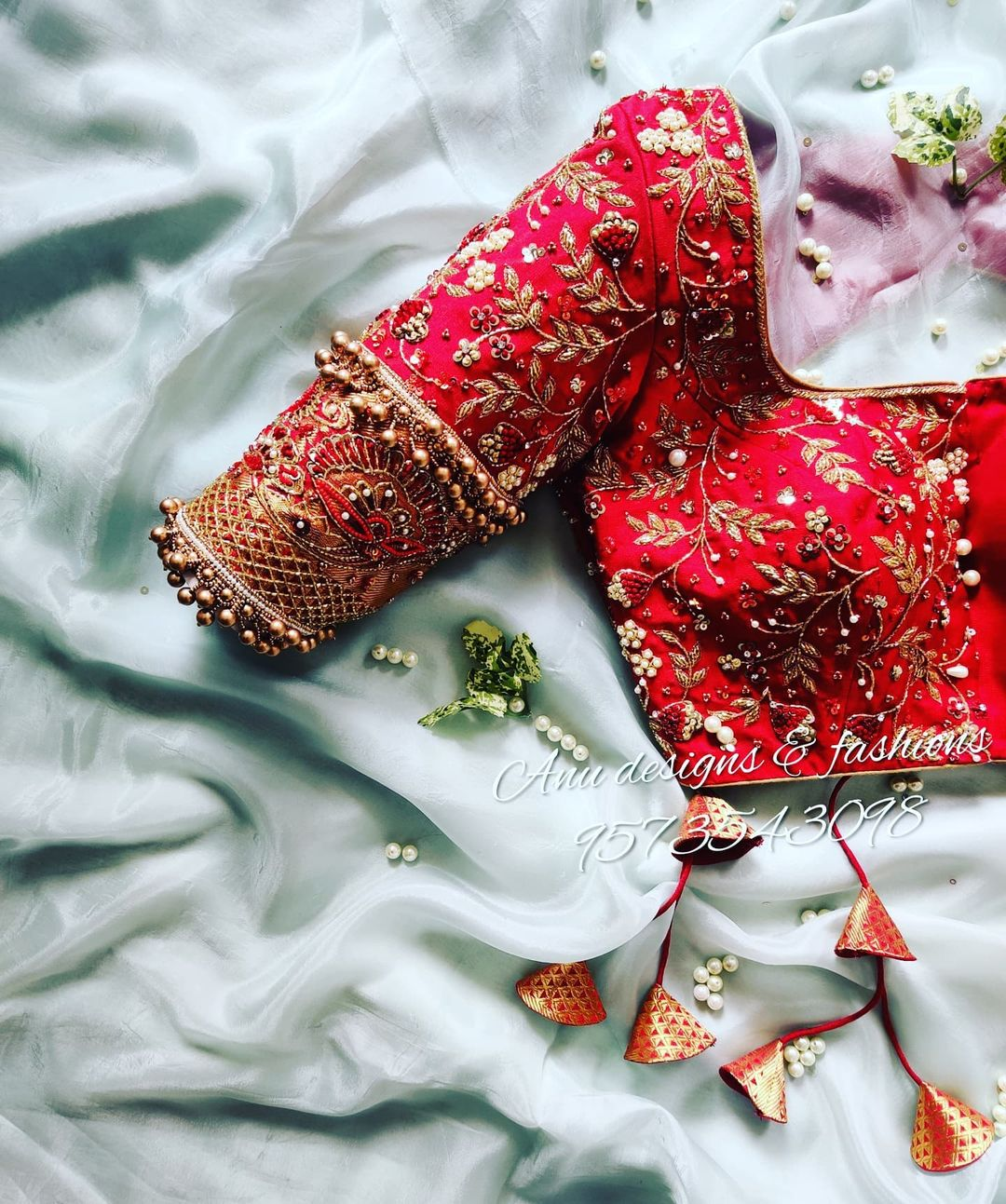 Stunning red color bridal or wedding blouse with floral and creeper hand embroidery maggam work.  2021-08-01