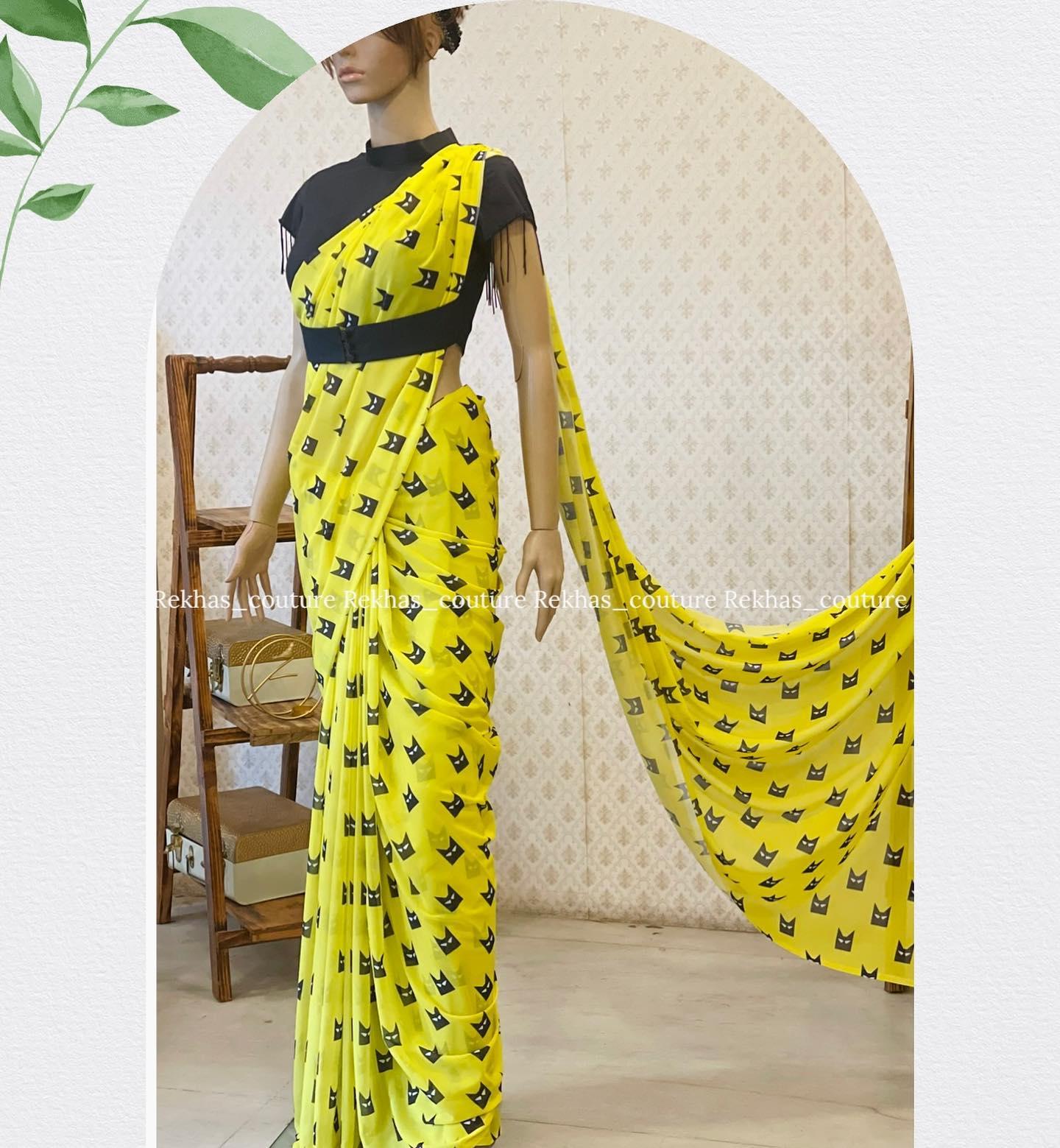 Gorgeous yellow color batman digital print saree and black blouse. 2021-08-02