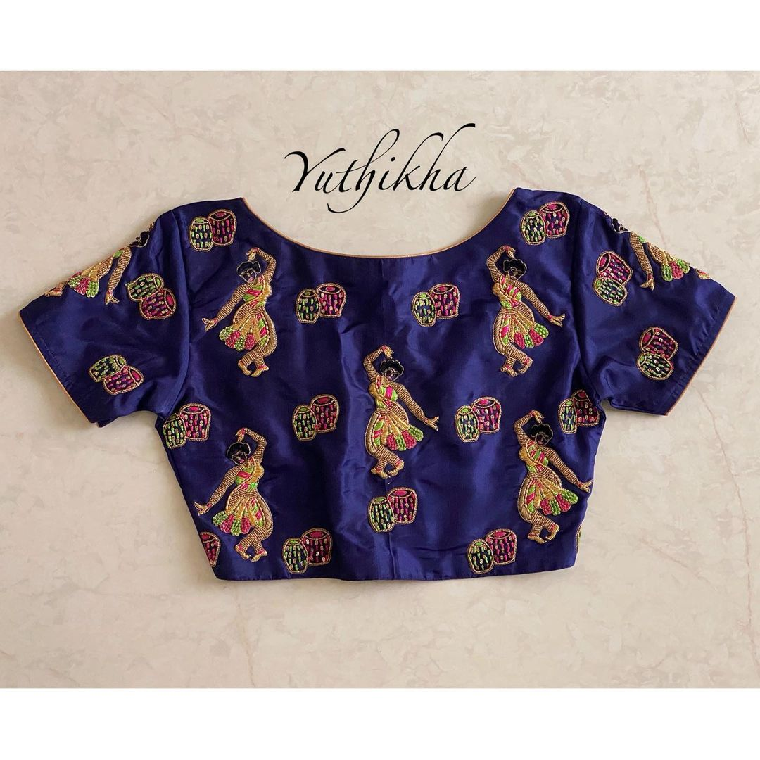 Gorgeous navy blue color boat neck blouse with dancing doll design hand embroidery thread maggam work allover.  2021-08-02