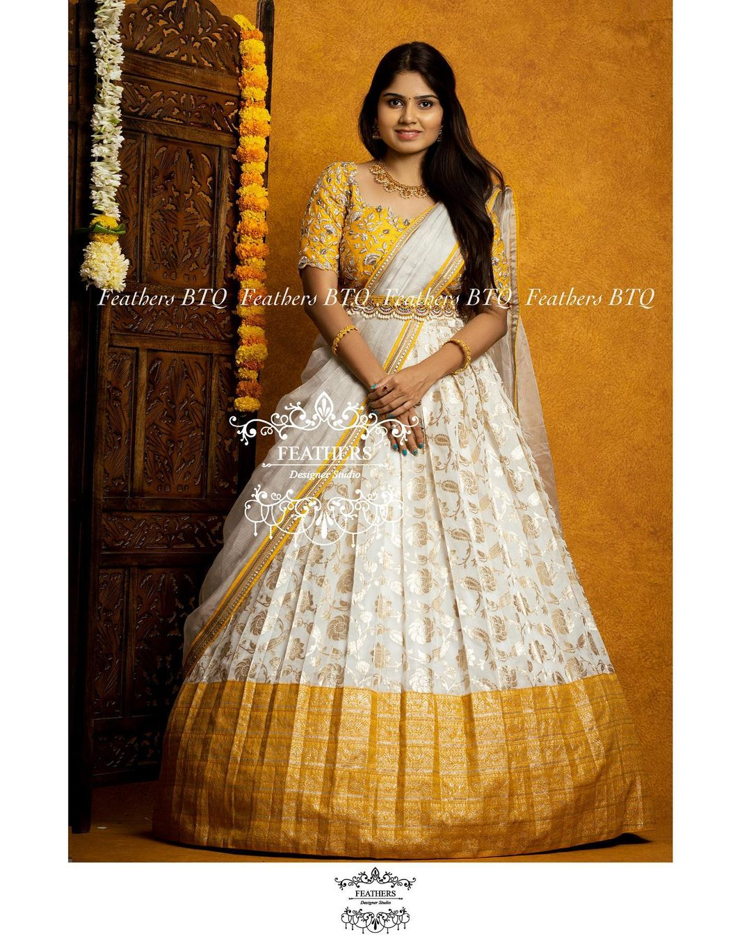 Stunning off white and yellow color combination bridal lehenga and blouse with net dupatta. Blouse with hand embroidery aari work.  2021-08-02