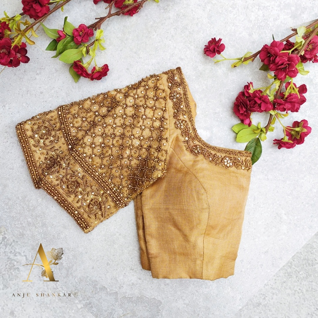 Gorgeous classy bridal blouse sleeves with floral bead and gold thread aari work. 2021-08-03