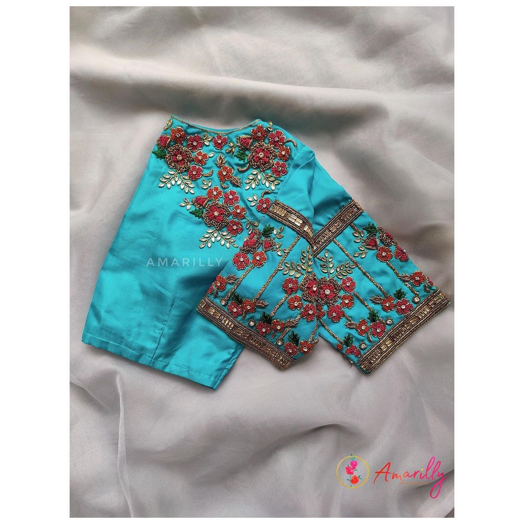 Gorgeous sky blue color bridal blouse with floral hand embroidery thread and kundan maggam work.  2021-08-03