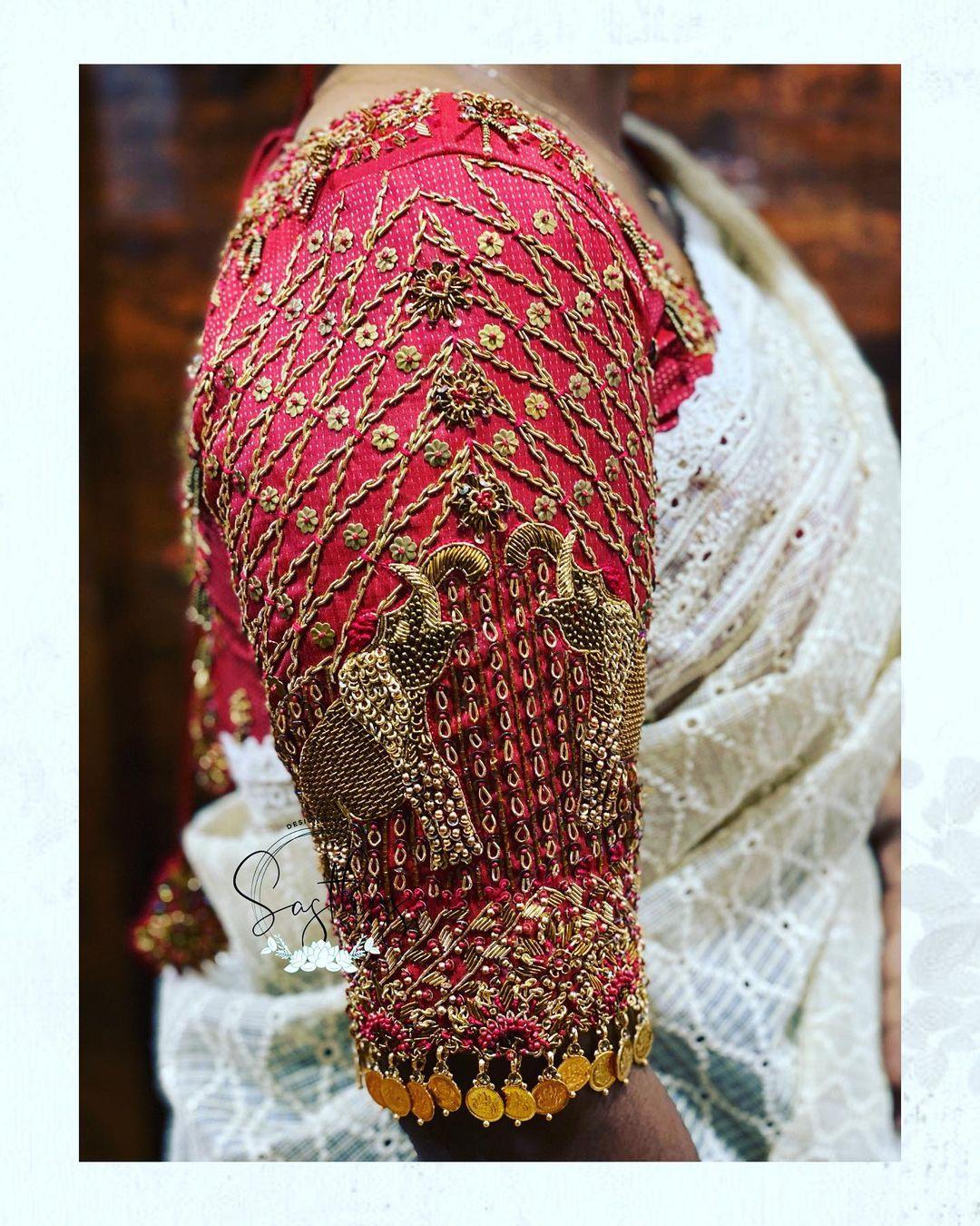 Stunning bridal blouse sleeve with elephant hand embroidery zardosi work.  2021-08-03