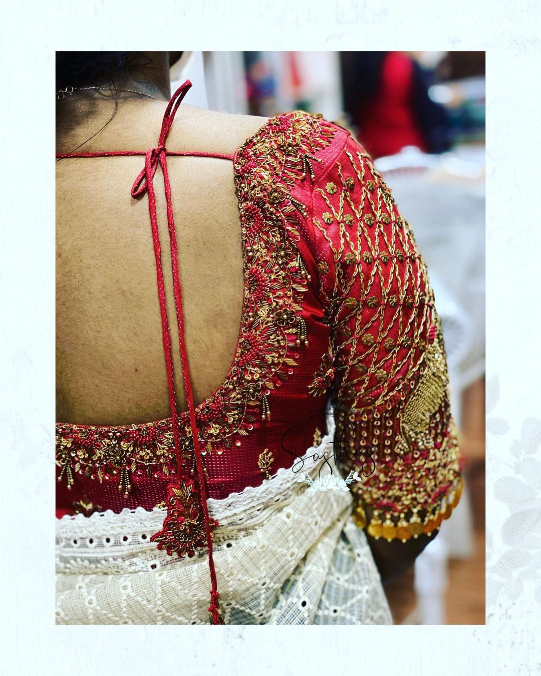 Stunning bridal blouse with elephant hand embroidery zardosi work. Blouse sleeves with coin hangings.  2021-08-03