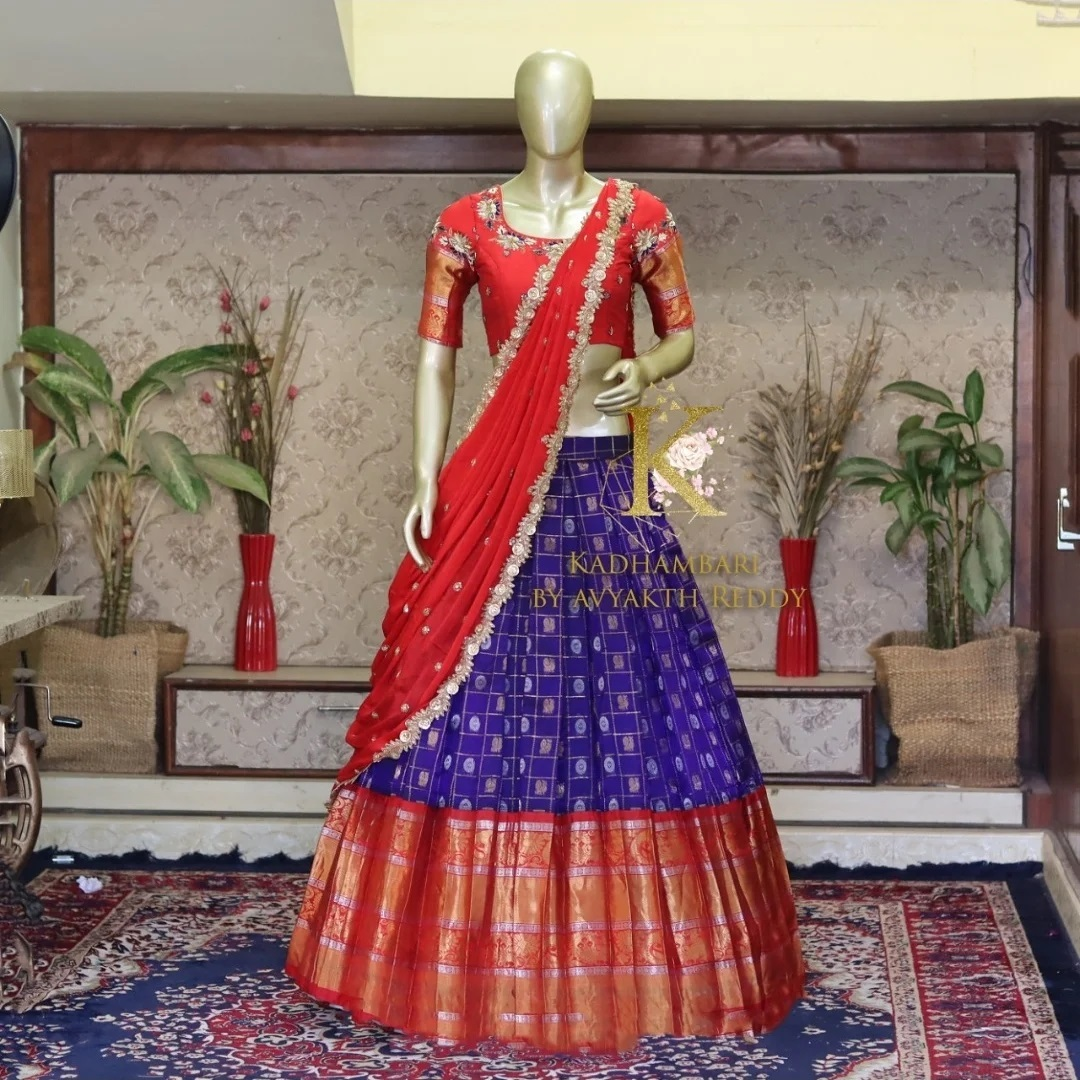 Stunning royal blue color checked bridal pattu lehenga and red blouse with cut work dupatta. Blouse with zardosi work. 2021-08-03