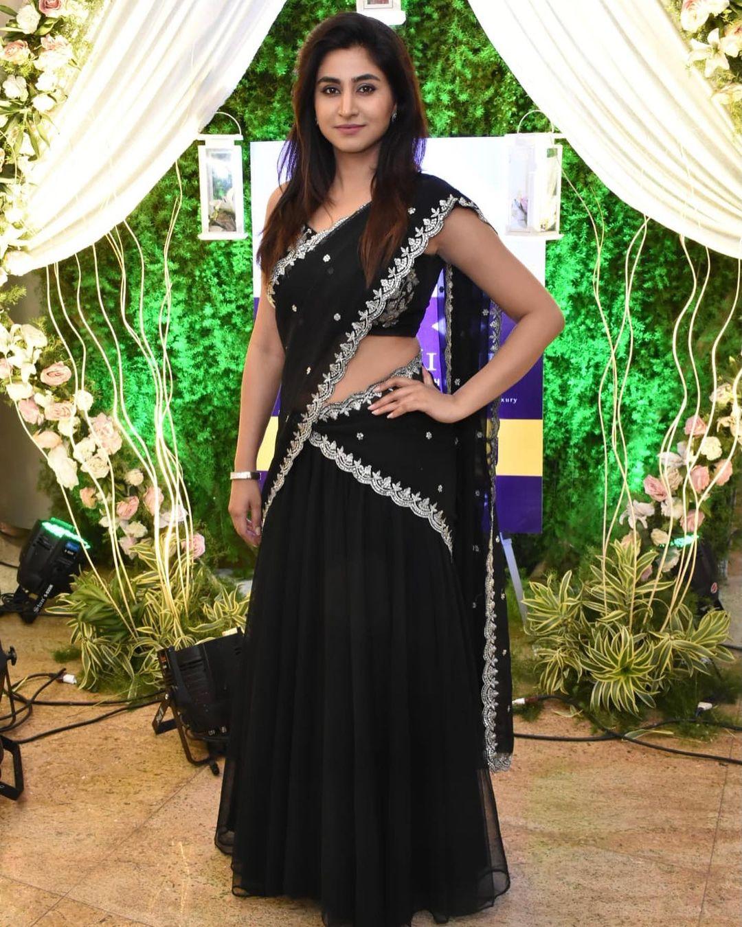 Gorgeous actress Varshini Soude Rajan in black half saree  for Hi life exhibition. 2021-08-04
