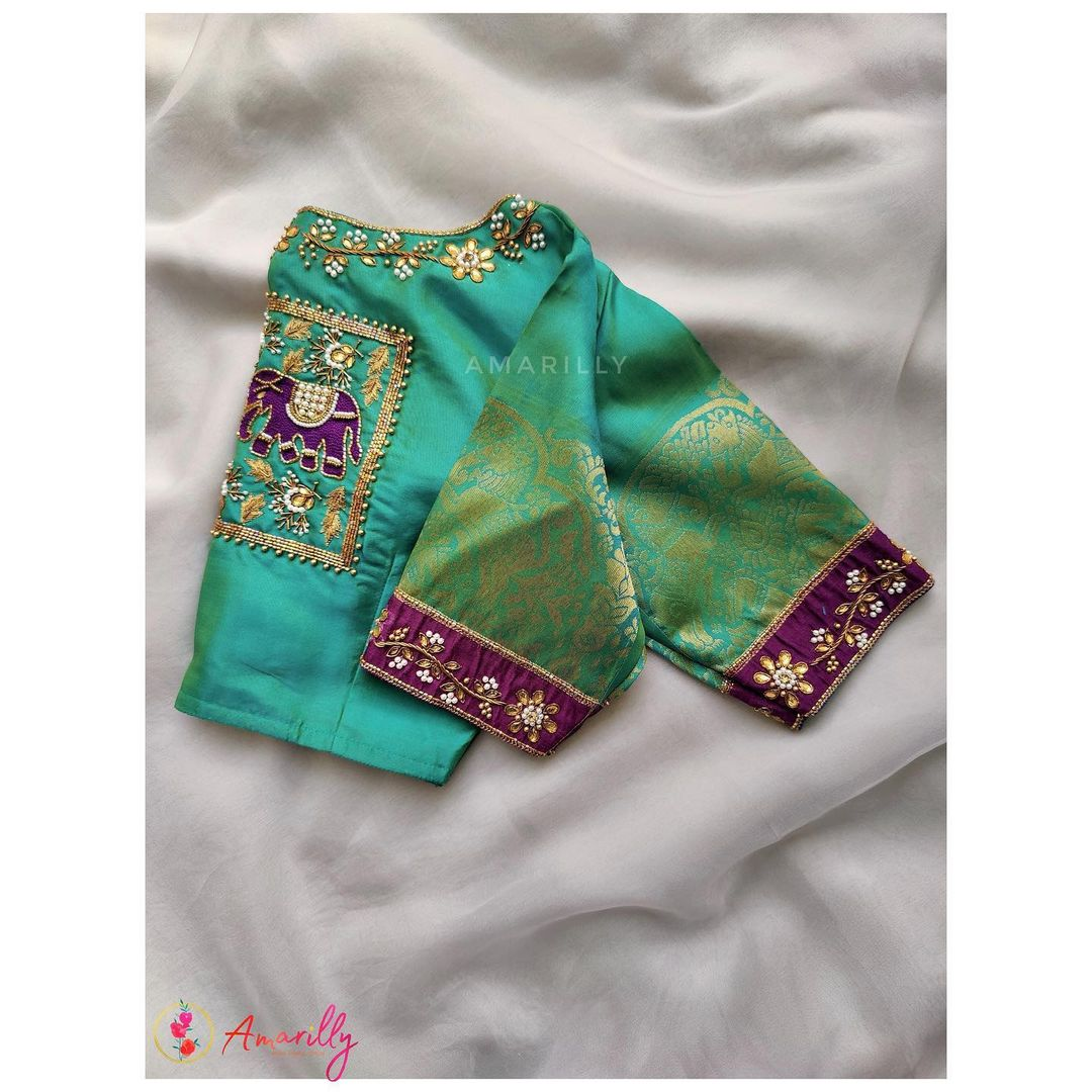 Gorgeous sea green color bridal blouse with elephant and creeper hand embroidery zardosi work.  2021-08-04