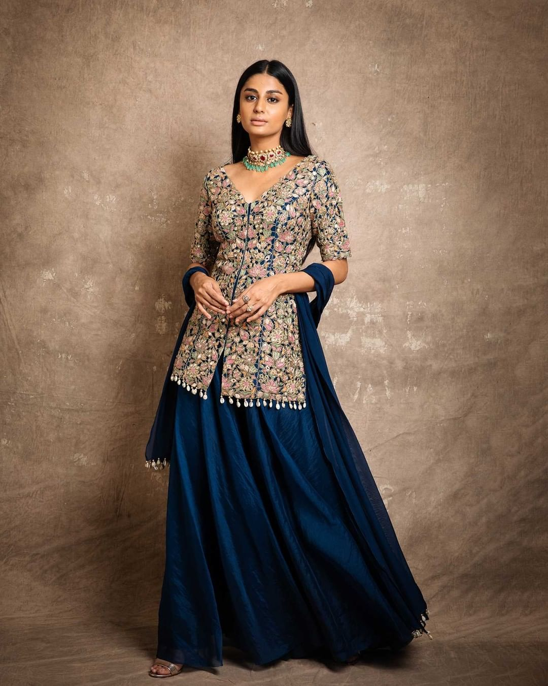 Intricate florals and royal affair of drapes for this festive season!  Here's a look of Blue tiered sharara with fan flower embroidered kurta with cowrie shell detailing and chiffon dupatta.  For further enquiries please connect with team on +91 7506633202 via call or WhatsApp. . 2021-08-04