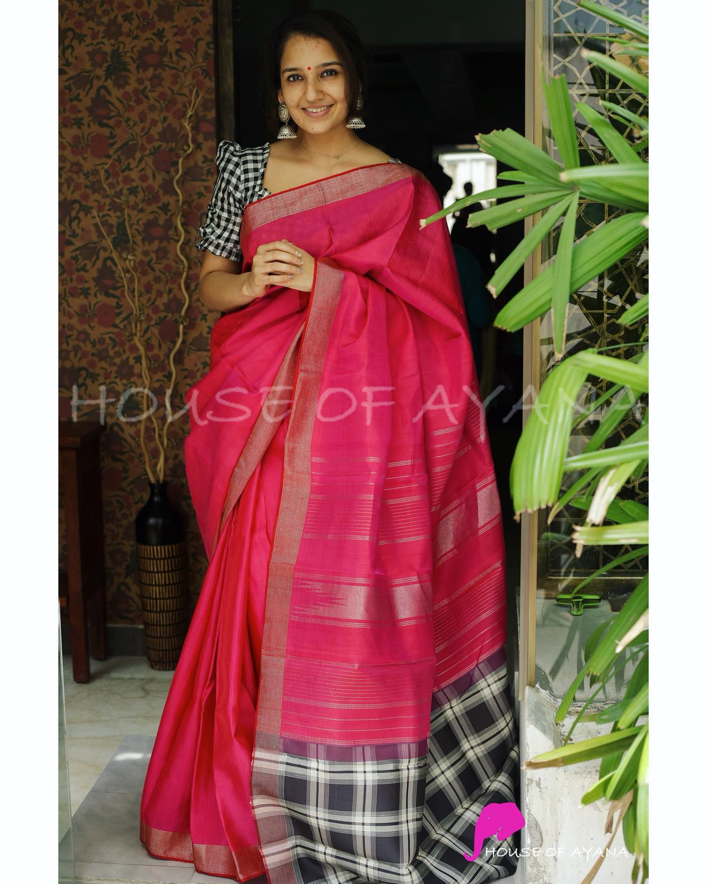 Saree: Kanjivaram silk saree handwoven with contrast checked pallu and silver zari borders in jute finish. Blouse: Black and White checked silk blouse with coordinated borders . Price : Rs. 13699.00. 2021-08-05